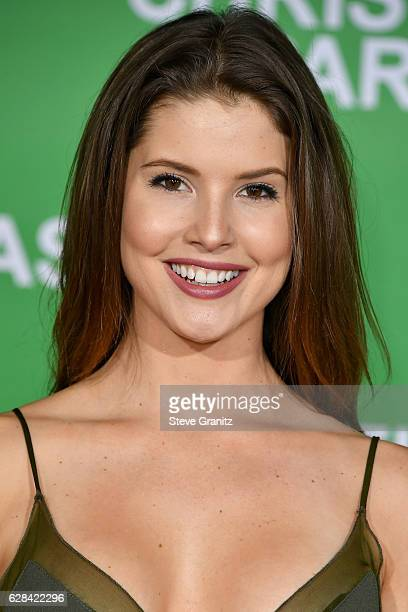 Actress Amanda Cerny attends the premiere of Paramount Pictures' 'Office Christmas Party' at Regency Village Theatre on December 7 2016 in Westwood...