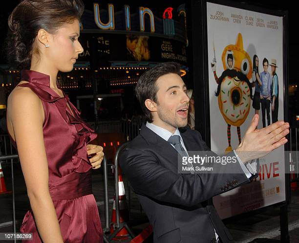 Actress Amanda Crew and actor Josh Zuckerman arrive at the Los Angeles premiere of 'Sex Drive' on October 15 2008 in Westwood California