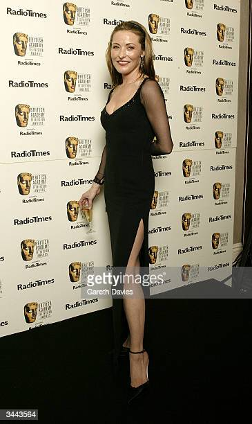 Actress Amanda Donahoe poses in the pressroom following The British Academy Television Awards at the Grosvenor House Hotel on April 18 2004 in London
