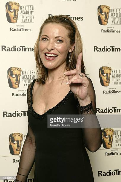 Actress Amanda Donahoe poses in the pressroom following the The British Academy Television Awards at the Grosvenor House Hotel on April 18 2004 in...
