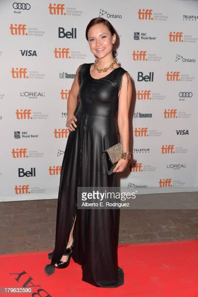 Actress Amanda Grace Cooper arrives at the All Cheerleaders Die premiere during the 2013 Toronto International Film Festival at Ryerson Theatre on...