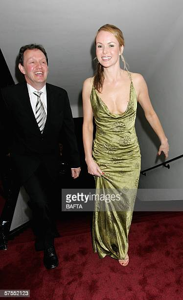 Actress Amanda Holden and actor Kevin Whately leave the stage having presented an award at the Pioneer British Academy Television Awards 2006 at the...