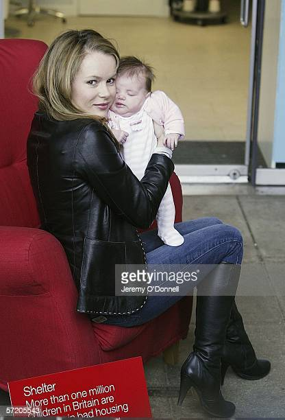 Actress Amanda Holden poses with her nine week old baby Lexi during Shelter's Red Chair Sitin photocall at the Oxo Tower Wharf on March 29 2006 in...