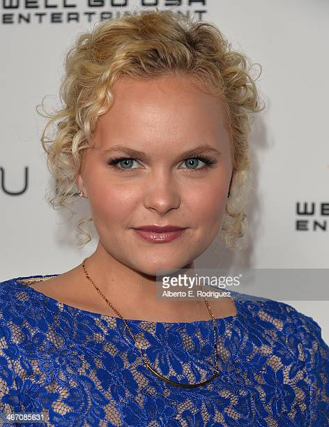 Actress Amanda Jane Cooper arrives to the premiere of Cavemen at the ArcLight Cinemas on February 5 2014 in Hollywood California