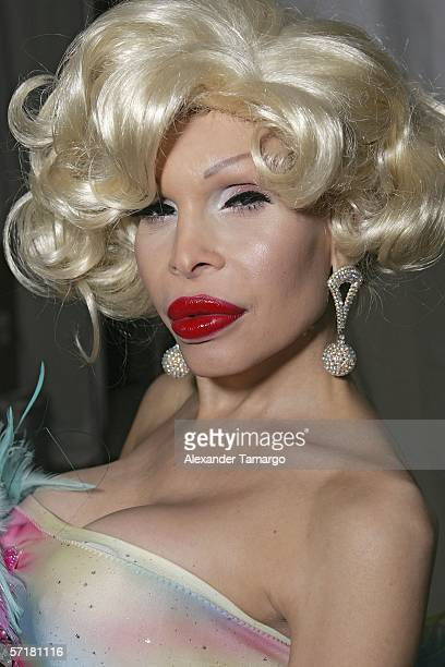 Actress Amanda Lepore poses backstage before the Heatherette fashion show during FUNKSHION fashion week on March 24 2006 in Miami Beach Florida