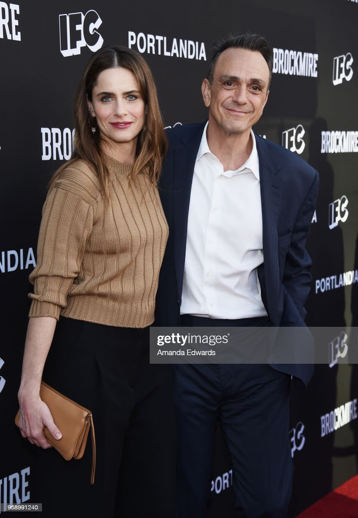 Actress Amanda Peet (L) and actor Hank Azaria arrive at IFC 's 'Brockmire' and 'Portlandia' EMMY FYC red carpet event at the Saban Media Center on May 15, 2018 in North Hollywood, California.