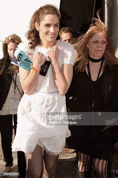 Actress Amanda Peet and casting director Jeanne McCarthy winners of the Robert Altman award for 'Please Give' attend the 2011 Film Independent Spirit...