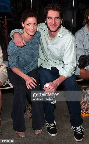 Actress Amanda Peet and writer David Benioff pose in the front row at the Thakoon Spring 2006 fashion show during Olympus Fashion Week at Bumble and...