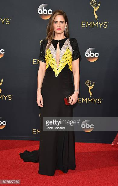 Actress Amanda Peet arrives at the 68th Annual Primetime Emmy Awards at Microsoft Theater on September 18 2016 in Los Angeles California