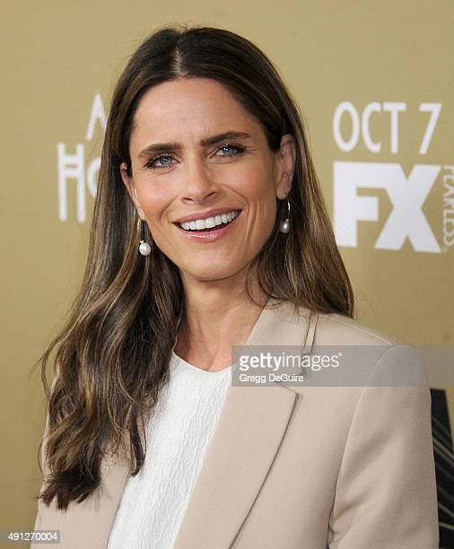 """Actress Amanda Peet arrives at the premiere screening of FX's """"American Horror Story: Hotel"""" at Regal Cinemas L.A. Live on October 3, 2015 in Los..."""