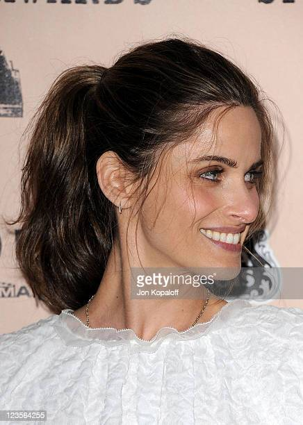 Actress Amanda Peet poses in the press room at the 2011 Film Independent Spirit Awards held at Santa Monica Beach on February 26 2011 in Santa Monica...