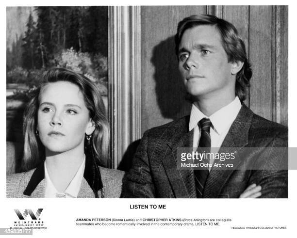 Actress Amanda Peterson and actor Christopher Atkins on the set of the Columbia Pictures movie Listen to Me circa 1989
