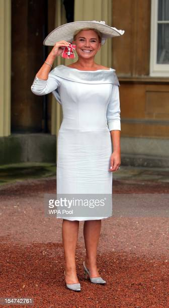 Actress Amanda Redman poses after she was made an MBE at a Royal Investiture ceremony at Buckingham Palace on October 25 2012 in London England