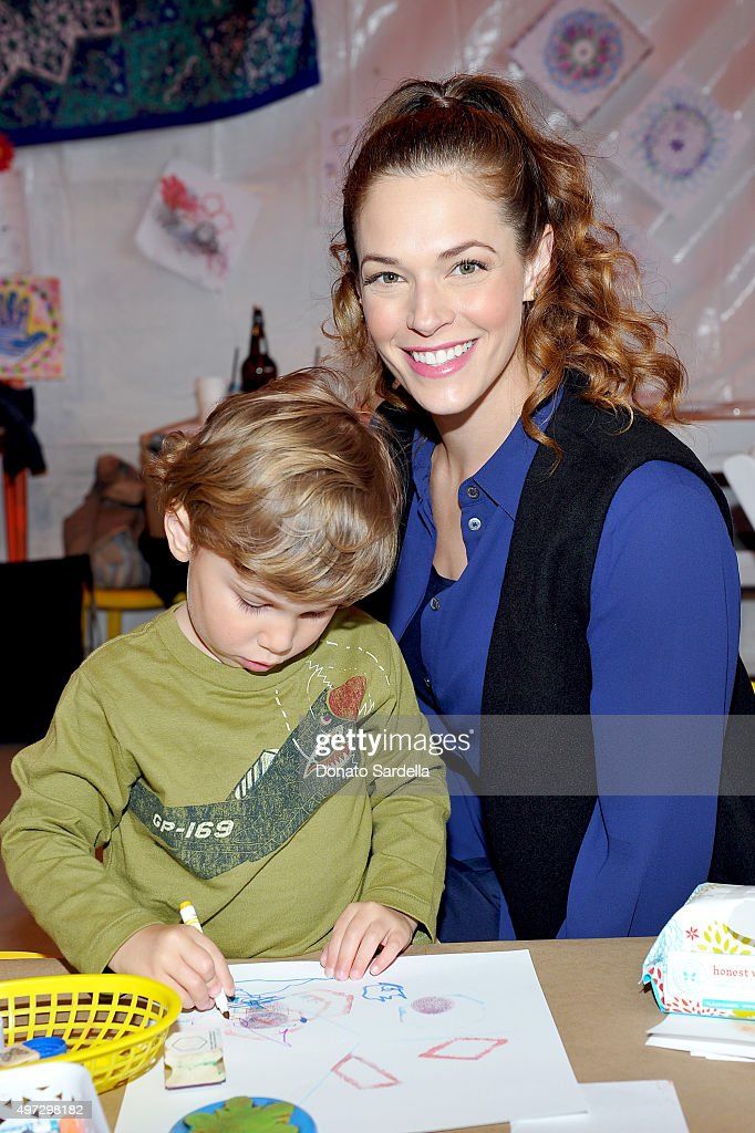 Actress Amanda Righetti (R) and Knox Addison Alan attend Express Yourself 2015 to benefit P.S. ARTS, providing arts education to 25,000 public school students each week at Barker Hangar on November 15, 2015 in Santa Monica, California.