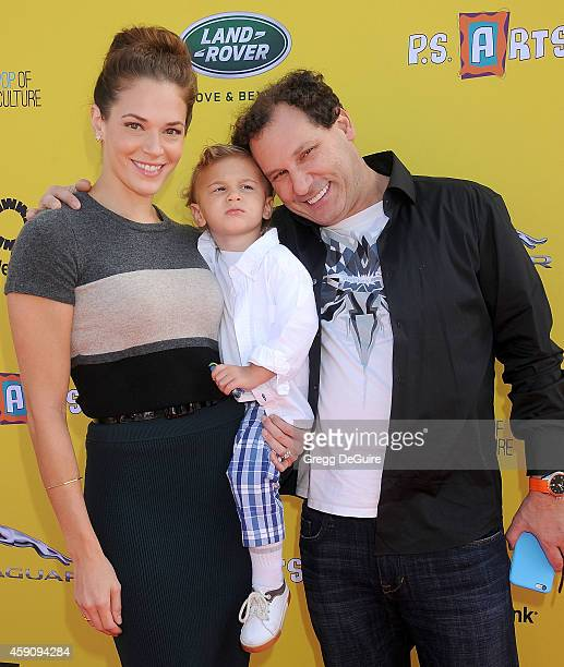 Actress Amanda Righetti son Knox Addison Alan and husband Jordan Alan arrive at the PS ARTS Express Yourself 2014 at The Barker Hanger on November 16...