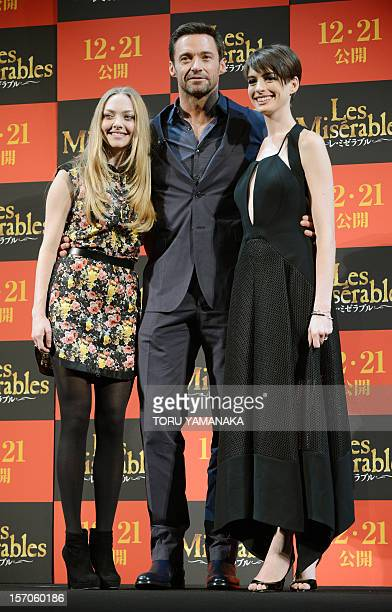 US actress Amanda Seyfreid Australian actor Hugh Jackman and US actress Anne Hathaway pose for photographers during an event to promote their latest...