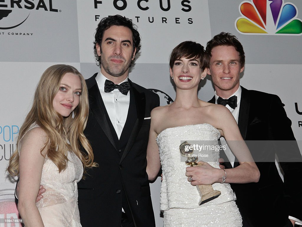 Actress Amanda Seyfried, actor Sacha Baron Cohen, actress Anne Hathaway, and actor Eddie Redmayne of 'Les Miserables' attend the NBC/Universal/Focus Features/E! Networks Golden Globe Awards Celebration Designed And Produced By Angel City Designs at The Beverly Hilton Hotel on January 13, 2013 in Beverly Hills, California.
