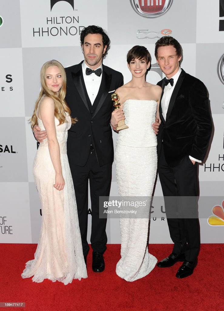 Actress Amanda Seyfried, actor Sacha Baron Cohen, actress Anne Hathaway, and actor Eddie Redmayne of 'Les Miserables' arrive at the NBC Universal's 70th annual Golden Globe Awards after party on January 13, 2013 in Beverly Hills, California.