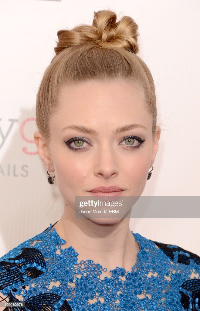 Actress Amanda Seyfried arrives at the 18th Annual Critics' Choice Movie Awards held at Barker Hangar on January 10, 2013 in Santa Monica, California.
