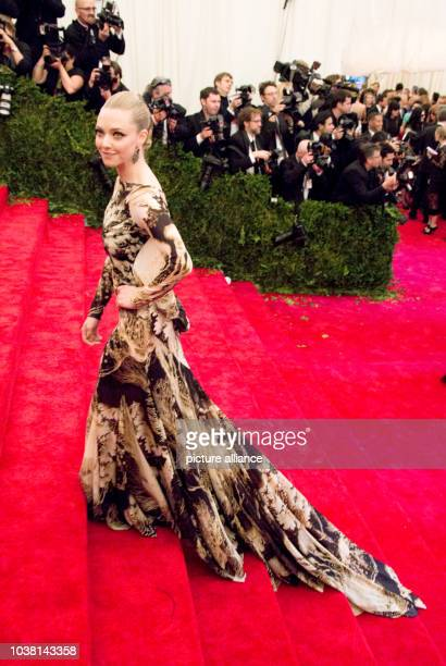 Actress Amanda Seyfried arrives at the Costume Institute Gala for the 'Punk Chaos to Couture' exhibition at the Metropolitan Museum of Art in New...
