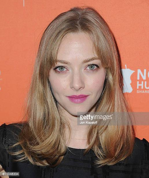 Actress Amanda Seyfried arrives at the Los Angeles' No Kid Hungry Dinner on September 28 2016 in Los Angeles California