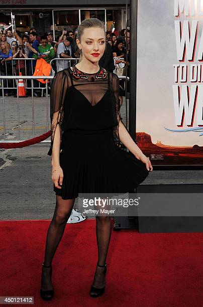 Actress Amanda Seyfried arrives at the Los Angeles premiere of 'A Million Ways To Die In The West' at Regency Village Theatre on May 15 2014 in...