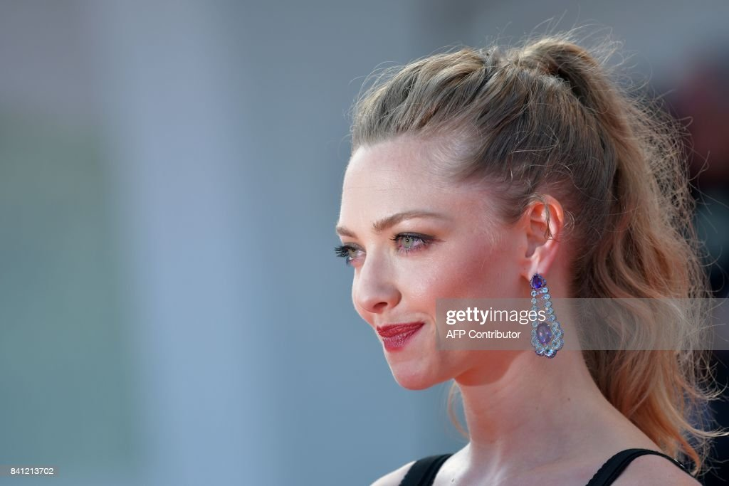 Actress Amanda Seyfried arrives for the premiere of the movie 'First Reformed' presented in competition at the 74th Venice Film Festival on August 31, 2017 at Venice Lido. / AFP PHOTO / Tiziana FABI