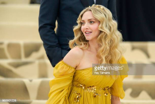 Actress Amanda Seyfried enters the Heavenly Bodies Fashion The Catholic Imagination Costume Institute Gala at The Metropolitan Museum on May 07 2018...