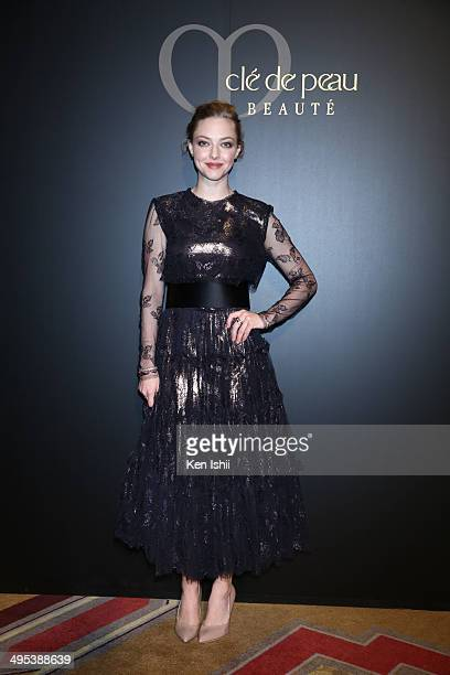 Actress Amanda Seyfried poses for photo as she attends 'Cle de peau BEAUTE 2014' promotional event at the Ritz Carlton Tokyo on June 2 2014 in Tokyo...