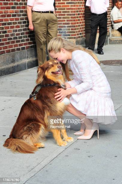 Actress Amanda Seyfried with her dog visits Late Show With David Letterman at Ed Sullivan Theater on July 30 2013 in New York City