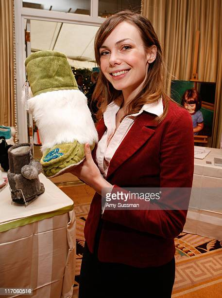 Actress Amanda Walsh holds a mukluks boot from Sweet Pedtooties at the Oh Canada Gift Suite at Peninsula Hotel on January 15 2010 in Beverly Hills...