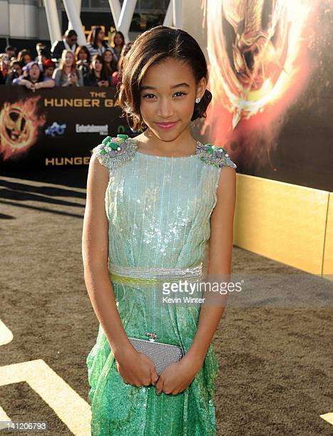 Actress Amandla Stenberg arrives at the premiere of Lionsgate's The Hunger Games at Nokia Theatre LA Live on March 12 2012 in Los Angeles California