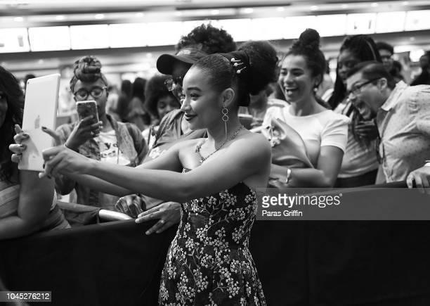 Actress Amandla Stenberg pose with fans at The Hate U Give Atlanta Red Carpet Screening at Regal Atlantic Station on October 3 2018 in Atlanta Georgia