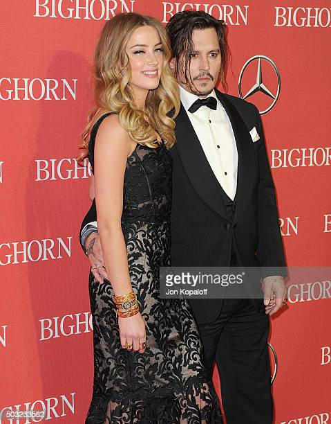 Actress Amber Heard and actor Johnny Depp arrive at the 27th Annual Palm Springs International Film Festival Awards Gala at Palm Springs Convention...