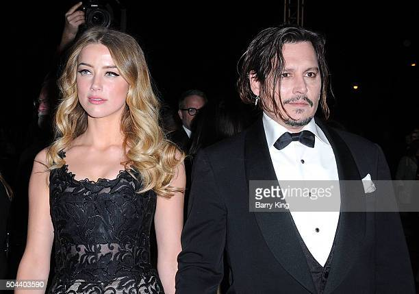 Actress Amber Heard and actor Johnny Depp arrive at the 27th Annual Palm Springs International Film Festival at Palm Springs Convention Center on...