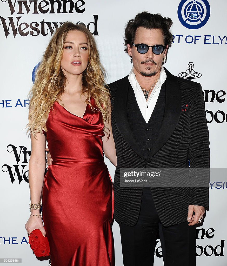 Actress Amber Heard and actor Johnny Depp attend Art of Elysium's 9th annual Heaven Gala at 3LABS on January 9, 2016 in Culver City, California.