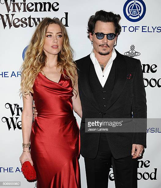 Actress Amber Heard and actor Johnny Depp attend Art of Elysium's 9th annual Heaven Gala at 3LABS on January 9 2016 in Culver City California