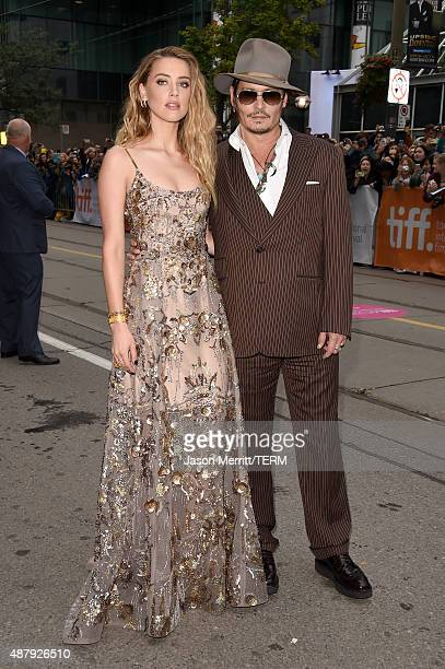 Actress Amber Heard and actorJohnny Depp attend The Danish Girl premiere during the 2015 Toronto International Film Festival at the Princess of Wales...