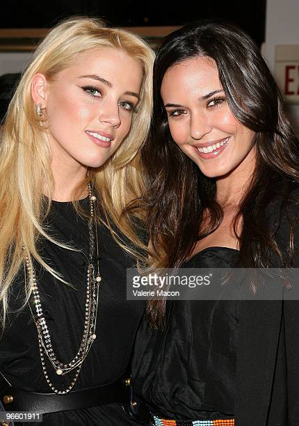 Actress Amber Heard and actress Odette Yustman attend the Tasya Van Ree art exhibit on February 11 2010 in Beverly Hills California