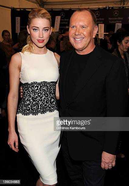 Actress Amber Heard and designer Michael Kors pose backstage at the Michael Kors Fall 2012 fashion show during MercedesBenz Fashion Week at The...