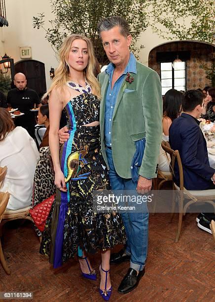 Actress Amber Heard and editorinchief W Magazine Stefano Tonchi attend Lynn Hirschberg Celebrates W Magazine's It Girls with Stuart Weitzman at AOC...