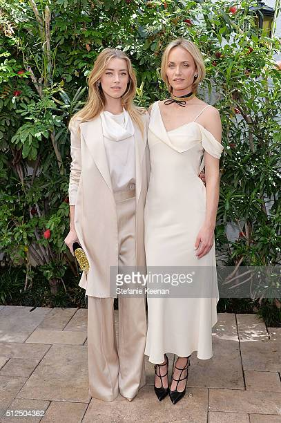 Actress Amber Heard and model Amber Valletta attend NETAPORTER Celebrates Women Behind The Lens at Chateau Marmont on February 26 2016 in Los Angeles...