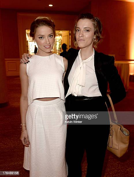 Actress Amber Heard and sister Witney Heard attend the Hollywood Foreign Press Association's 2013 Installation Luncheon at The Beverly Hilton Hotel...