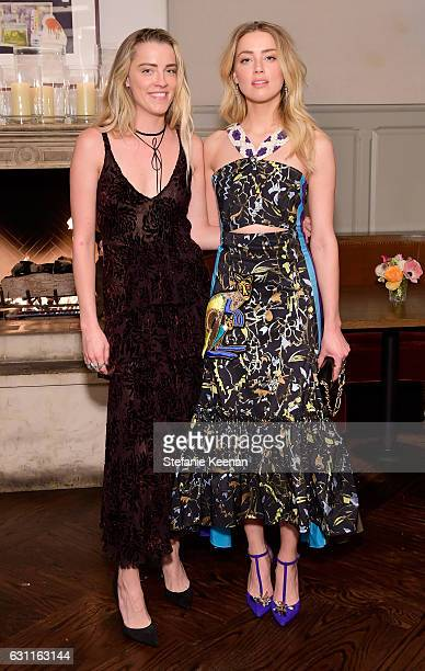Actress Amber Heard and Whitney Heard attend Lynn Hirschberg Celebrates W Magazine's It Girls with Stuart Weitzman at AOC on January 7 2017 in Los...