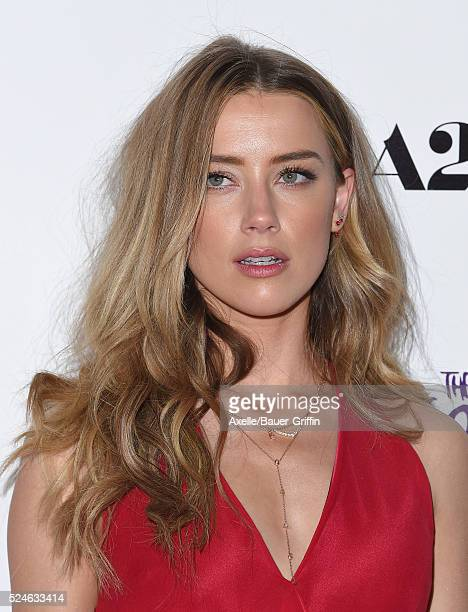 Actress Amber Heard arrives at A24/DIRECTV's 'The Adderall Diaries' Premiere at ArcLight Hollywood on April 12 2016 in Hollywood California