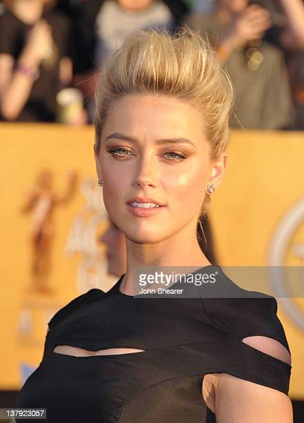 Actress Amber Heard arrives at The 18th Annual Screen Actors Guild Awards broadcast on TNT/TBS at The Shrine Auditorium on January 29 2012 in Los...