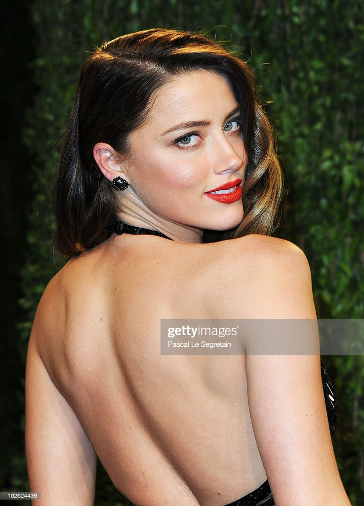 Actress Amber Heard arrives at the 2013 Vanity Fair Oscar Party hosted by Graydon Carter at Sunset Tower on February 24, 2013 in West Hollywood, California.