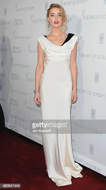 Actress Amber Heard arrives at The Art Of Elysium 8th Annual Heaven Gala at Hangar 8 on January 10, 2015 in Santa Monica, California.