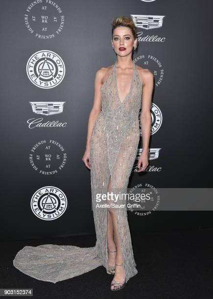 Actress Amber Heard arrives at The Art of Elysium's 11th Annual Celebration Heaven at Barker Hangar on January 6 2018 in Santa Monica California