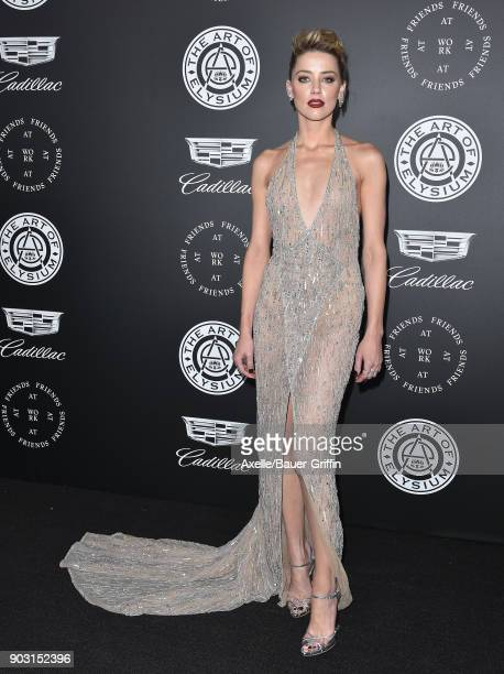 Actress Amber Heard arrives at The Art of Elysium's 11th Annual Celebration Heaven at Barker Hangar on January 6 2018 in Santa Monica California